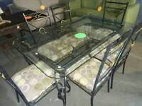 6 seater glass and wrought iron dinning table and 6 chairs