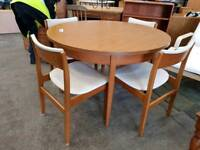 Round extendable table with four chairs