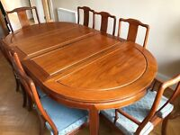Rosewood extendable dining table with 6 chairs and 2 carvers