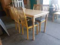 Modern rectangular dining table with 4 leather topped chairs