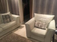 Leather cream sofa chair and pouffe comfy and in good condition house move forces sale
