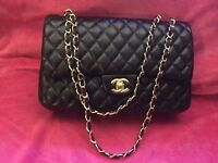 Brand new Chanel Classic Double Flap Handbag in Black with Gold Chain
