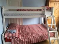 Wooden triple bunk bed