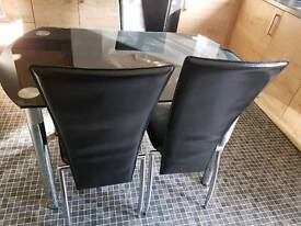 Extending glass dining table and 4 chairs