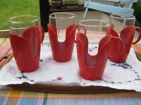 VINTAGE GLASSES IN RED HOLDERS