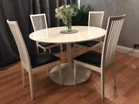 White gloss dining table with 4 chairs