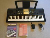 Yamaha keyboard with music book and pedal great condition