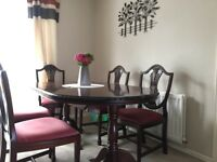 extendable dining room table, 2 carver chairs and 4 chairs along with other matching furniture