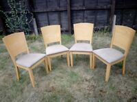 4 light coloured wooden dining chairs with upholstered seats - price is for all 4