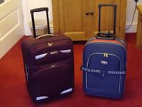 SUIT CASE ON WHEELS X2 IN VERY GOOD CLEAN CONDITION .