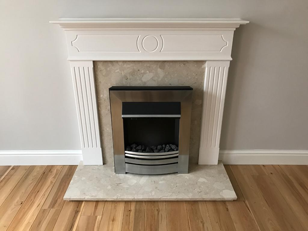 Fireplace surroundin Warmley, BristolGumtree - Fireplace surround electric fire. Open sell separately for an agreed price. White wood finished surround with cream quarts/marble style hearth and back panel. Size W107cm H105cm D40cm