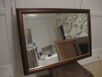 Traditionally-styled Laura Ashley mirror with wood finish