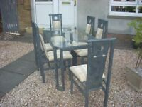 DINNING TABLE(METAL) AND 6 WOODEN CHAIRS .MATCHING . £100.