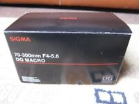 New, Unused Sigma 70- 300 m DG Macro lens. [ Boxed, packing,paperwork]
