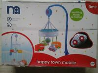 Mothercare happy town mobile. Brand new in box, never used.