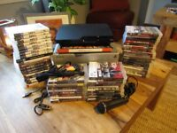 PS3 Slim 250 GB Incl 1 dual shock controller, 1 microphone, 1 earpiece and 52 games
