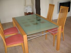 Ligne Roset extendable glass dining table and four chairs