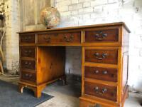 Antique pedestal leather top desk with 9 drawers