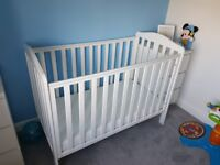 immaculate baby cot has a small mark in one corner