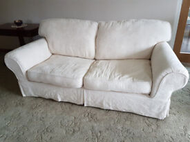 3 Seater Sofa with Natural coloured loose cover in excellent condition Heigh 94cm 206cm Depth 97cm