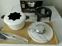 Brand New boxed Elite Cast iron fondue set