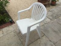 Four Plastic garden chairs