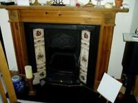 Victorian reproduction fireplace, black surround and tile panels. Wooden surround also included