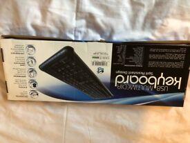 Brand new USB Multimedia Keyboard Spill Resistant Design. Still in a box.