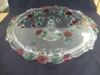 Glass cake stand with decorative red roses