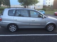 A 54 plate silver 5 door Kia carens crdi, really low mileage at 41,000, new mot. £795ono