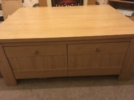 Heavy coffee table in very good condition with 4 draws