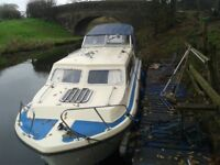 23 foot norman cruiser,moored on the lancaster canal,9hp yamaha outboard recently serviced