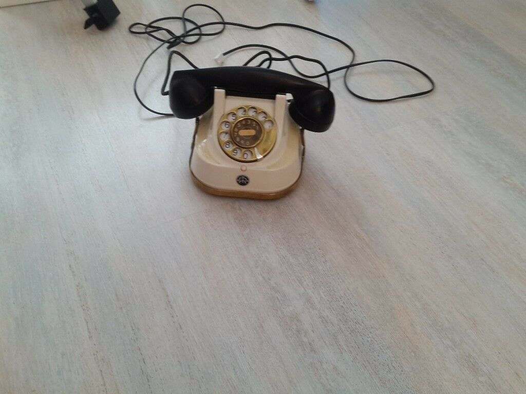 Antique telephone in working order, cream with brass dial and handle, excellent condition for age