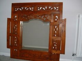 MIRROR IN CARVED WOODEN FRAME WITH SHUTTER DOORS