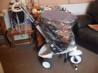 Mookie toys Smart Trike with rain cover
