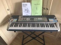 Casio LK-215 Electronic Key Lighting Keyboard with Adaptor , Stand , Song Book and User Guide