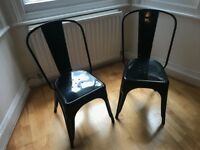 Pair of industrial black metal dining chairs (Tolix style)