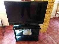 32'' Toshiba Regaza Flat Screen TV, dvd player and stand