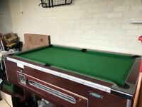 Pub style pool table with a slate bed and coin mechanism