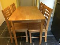 Table and 4 chairs for sale.