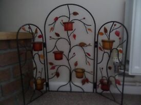 Unusual wrought iron decorative fire screen with matching tea light holder