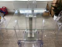 Glass dinning table with 4 plastic chairs