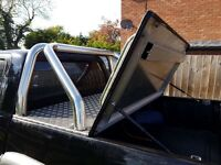 Toyota hilux mountain top and roll bar