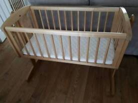Solid wood swinging crib with mattress
