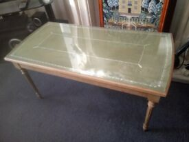 a mid 20th century beech effect occasional table with green tooled top under gla