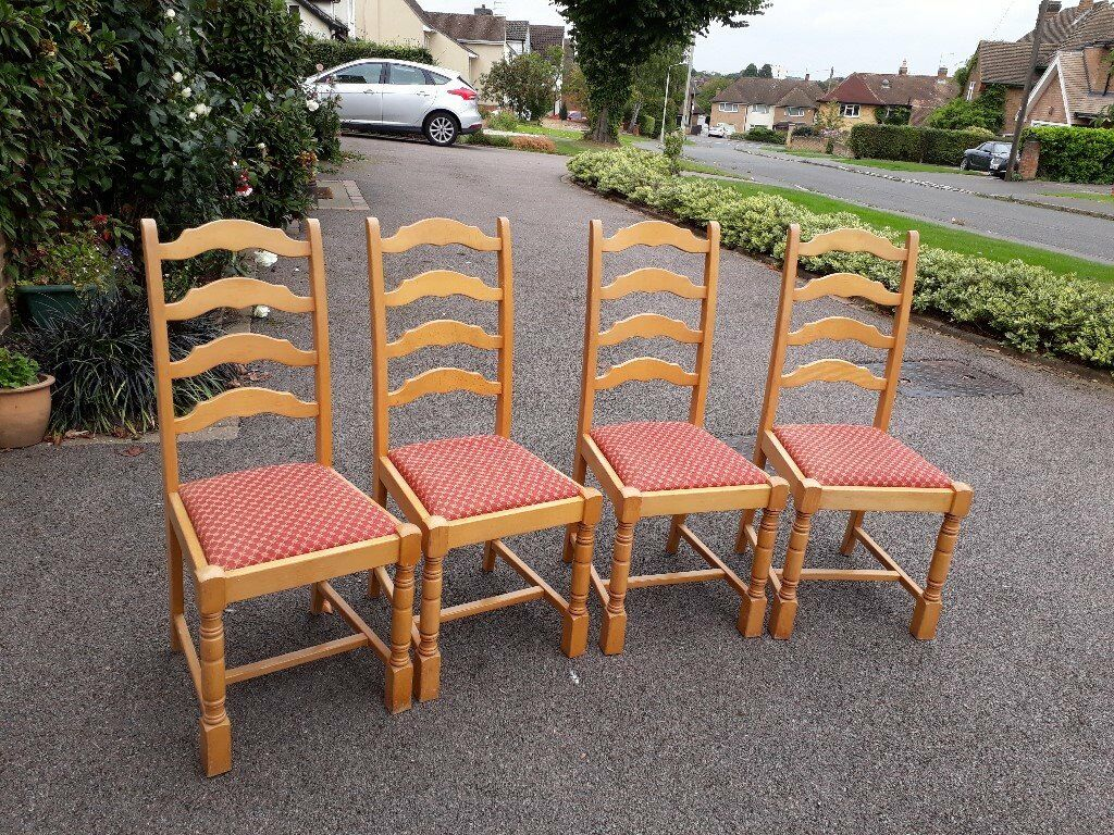 4 solid light wood dining chairs