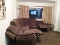 Corner sofa with electric recliners
