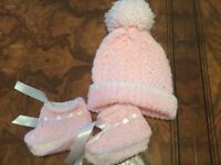 Hand knitted baby cardigans hats and bootees