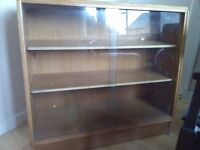 glass fronted book case- must be collected this week