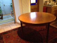 Vintage G Plan round (extendable) dining table in good condition with 4 chairs.